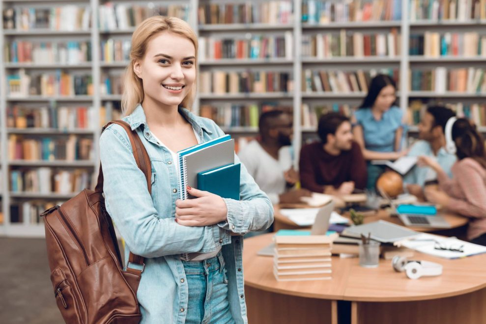 group-ethnic-multicultural-students-sitting-library-min-min (1)